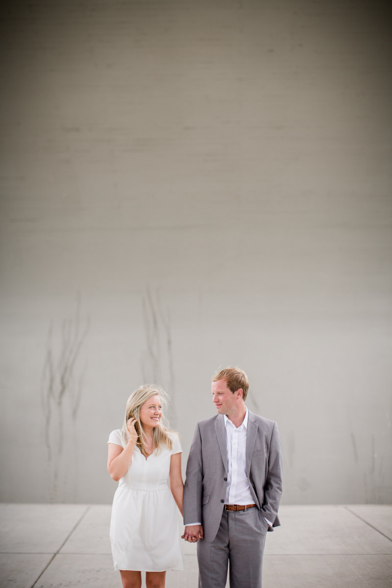 Standing under an underbridge by Knoxville Wedding Photographer, Amanda May Photos.
