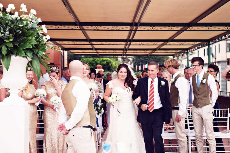 Bride and father walk down the isle for the ceremony