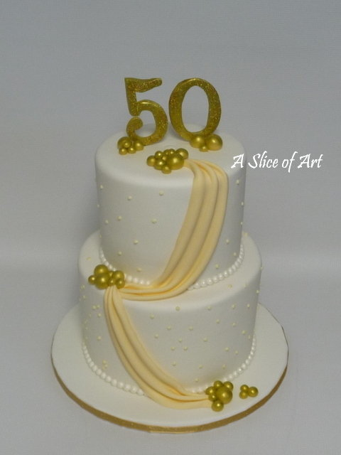 gold swag 50th anniversary cake