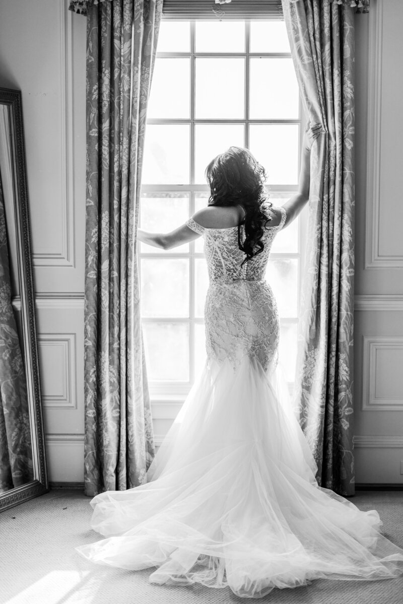 bride standing in window at great marsh estate wedding in charlottesville virginia by costola photography