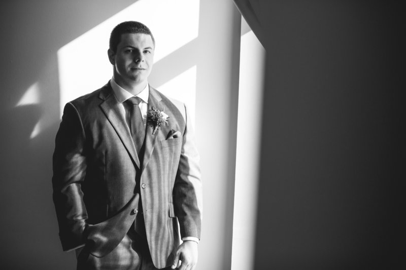 black and white groom portrait with shadows