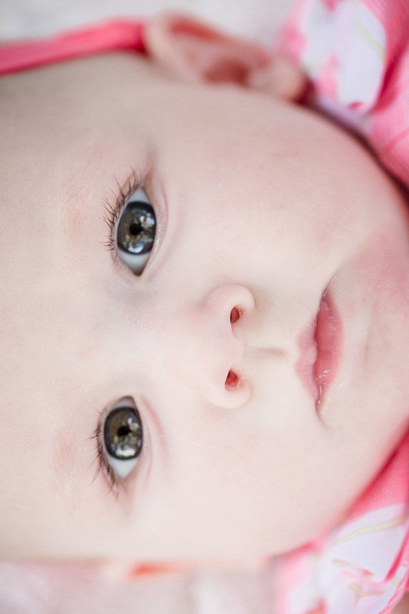 Close up of little girl's eyes laying on her back by Knoxville Wedding Photographer, Amanda May Photos.