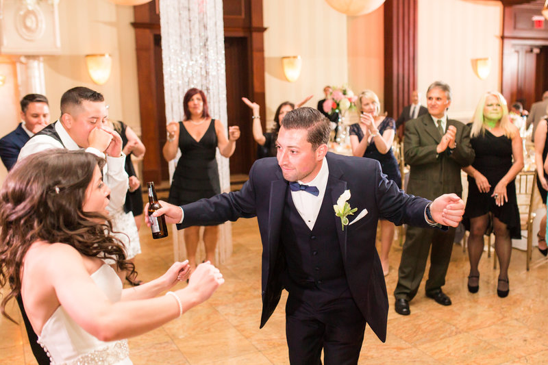 Groom dancing with his bride
