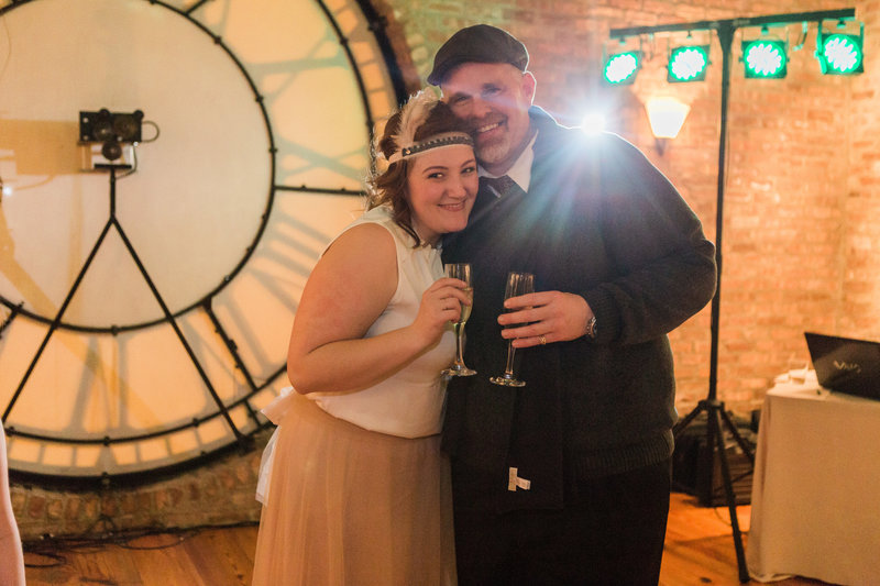 Hadassah and husband, Corey, share a New Years toast at Studio Manarchy in Chicago