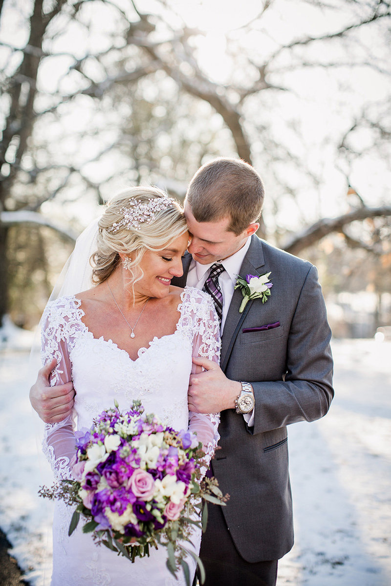 Groom's hands keeping bride warm at snowy winter wedding at Historic Westwood Wedding Venue by Knoxville Wedding Photographer, Amanda May Photos.