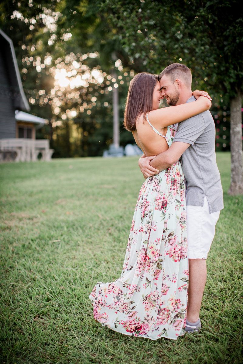 Hugging tight around his neck at estate of grace by Knoxville Wedding Photographer, Amanda May Photos.