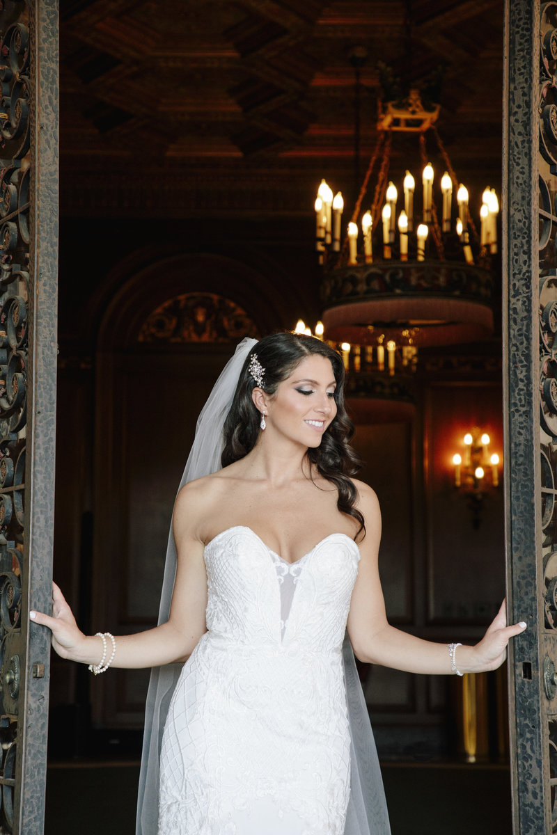 bride holing open cast iron gate
