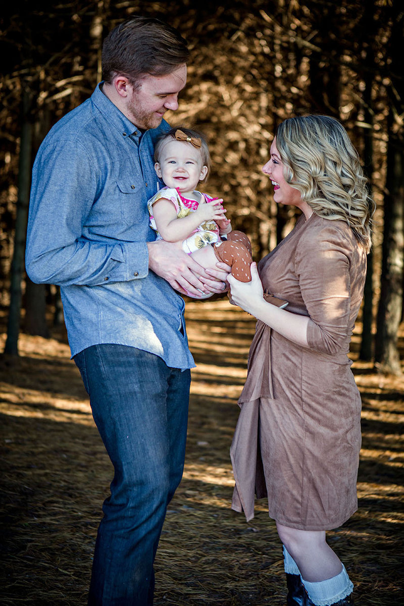 Family of three at the Fruit and Berry Patch in Halls by Knoxville Wedding Photographer, Amanda May Photos.