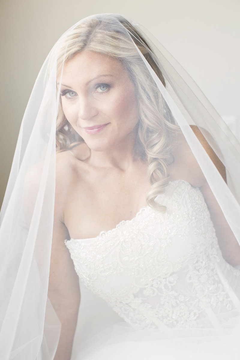 portrait of bride  smiling under veil