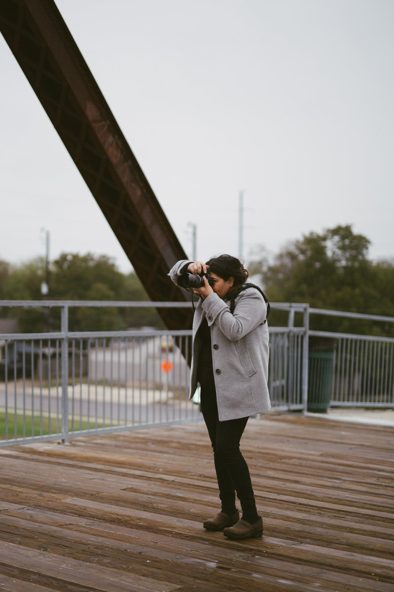 San Antonio Photographer Irene Castillo of Expose The Heart taking picture at Hays Street Bridge
