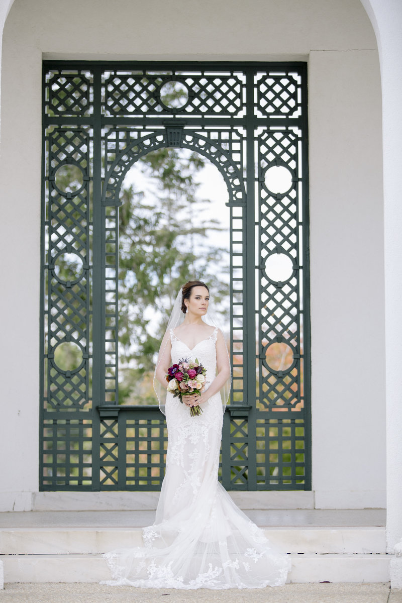 fulll length bridal portrait in front of green gate