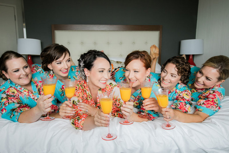 bridesmaids-on-bed
