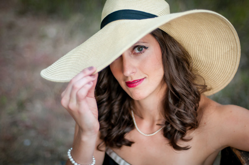 Female entrepreneur poses with glam hat
