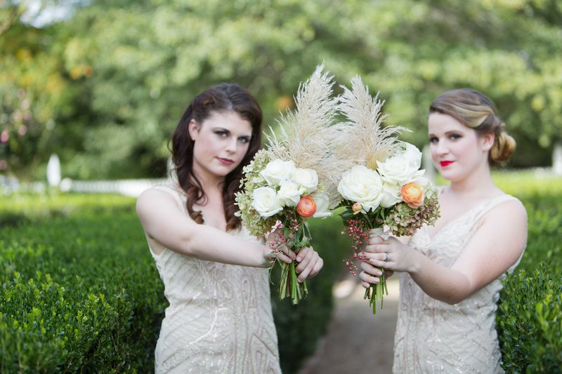 Great gatsby inspired bridesmaids hold fern bouquets