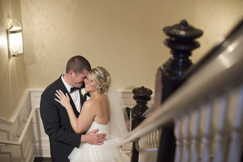 bride and groom posed on the stairs at clarks landing