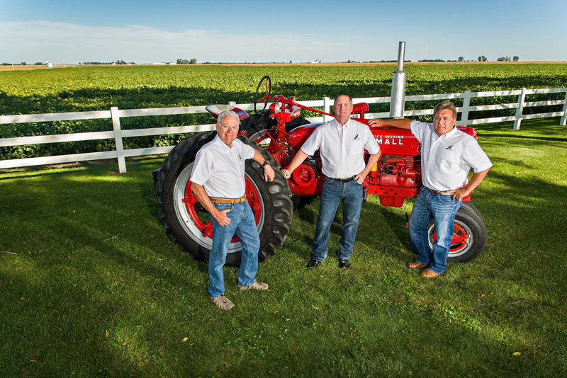 Members of LandPro of Illinois  stand near their tractors