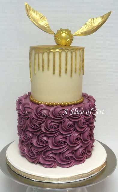 rosette cake with gold ganache and  handmade snitch