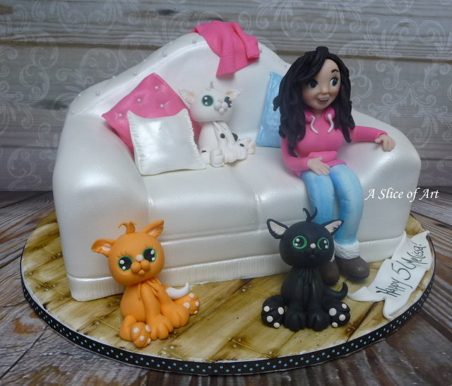 handcarved sofa cake with fondant characters