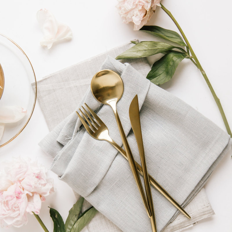 brass utensils silverware linen napkins peonies