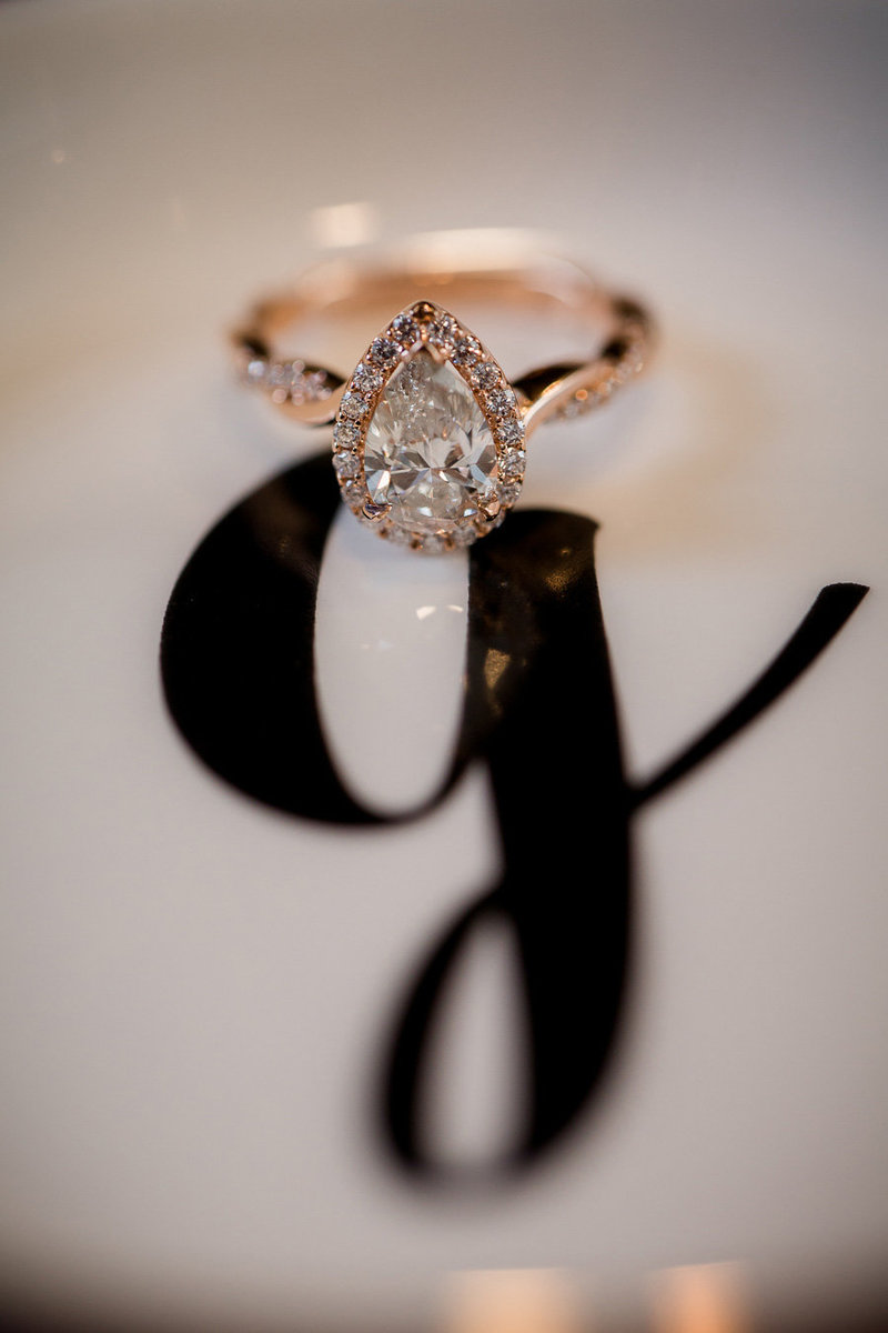 Tear Drop Engagement ring sitting on a monogrammed tray by Knoxville Wedding Photographer, Amanda May Photos.