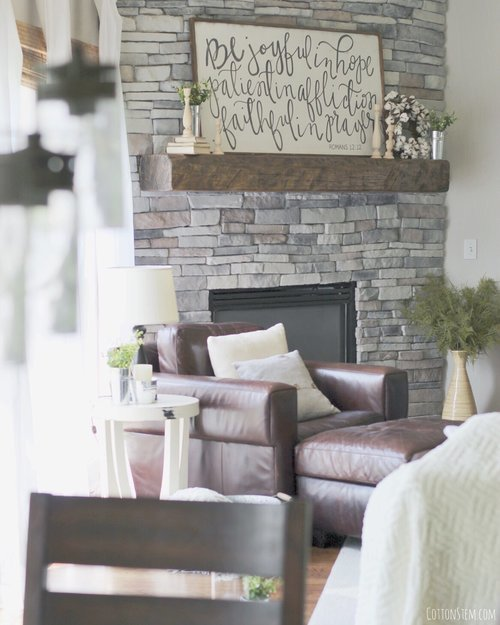 farmhouse-living-room-stacked-stone-fireplace-reclaimed-wood-mantle-2