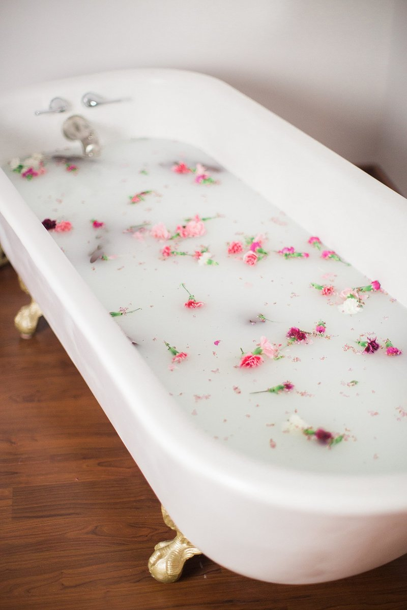 milk bath boudoir detail in clawfoot tub with flowers
