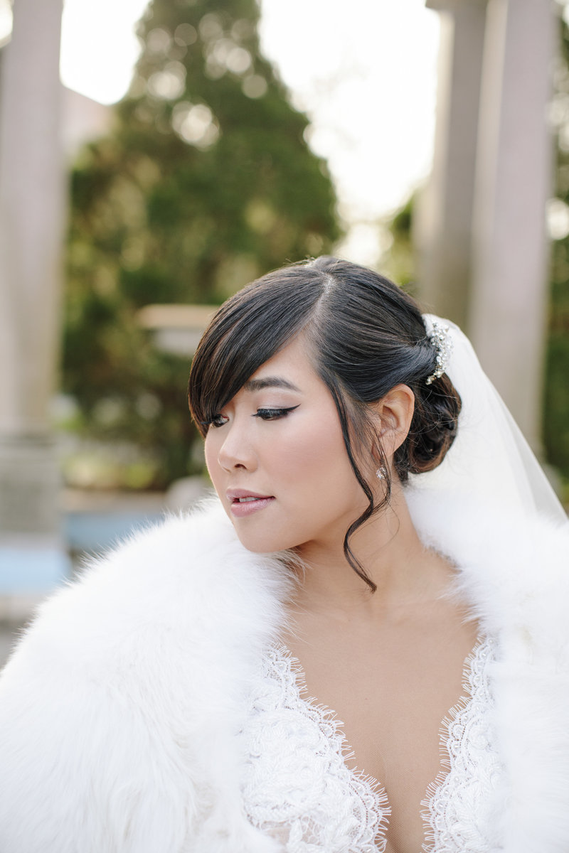 bride in white fur looking away at monmouth university
