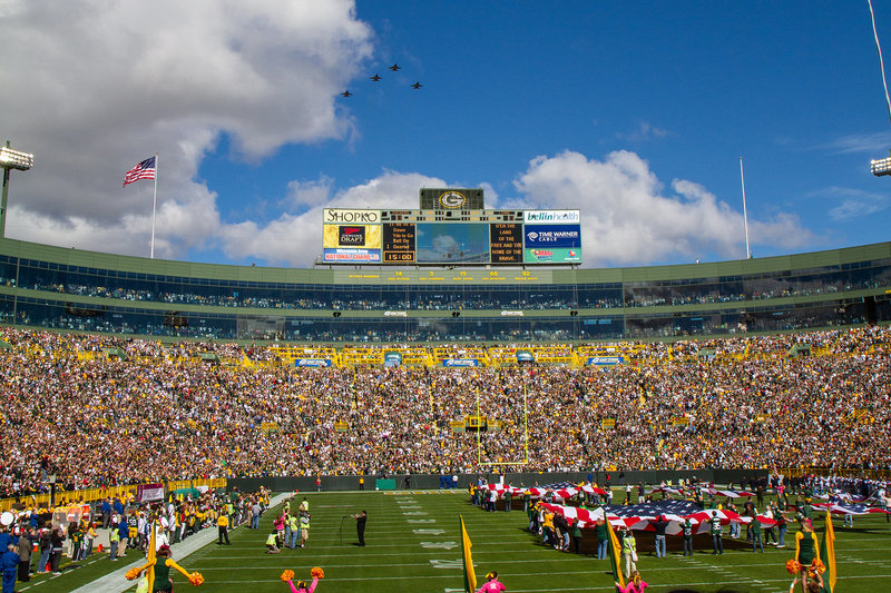 lambeau field with military jet flyover