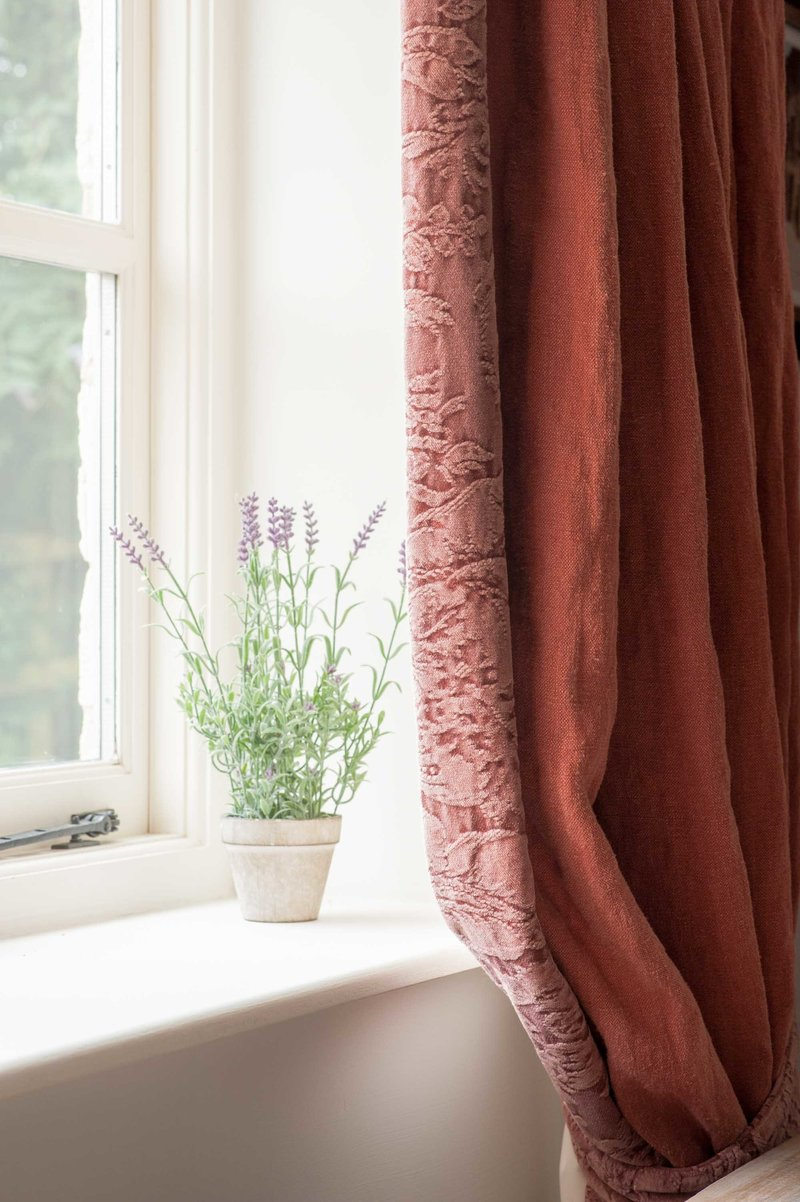 Curtains made from Arte di Vita fabrics hanging in English cottage decorated by Arte di Vita Interiors.