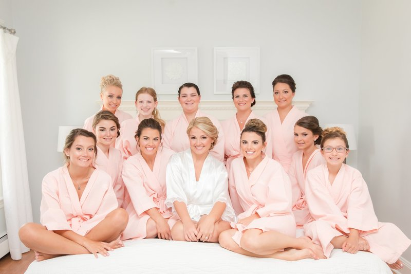 Bridesmaids in peach robes