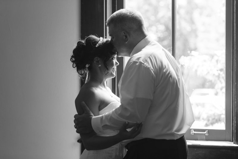A sweet moment between a bride and her dad