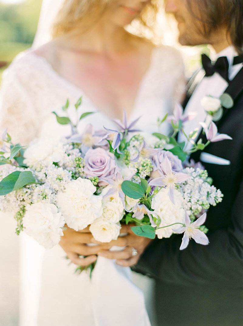 Romantic wedding bouquet with dusty purple and white flowers