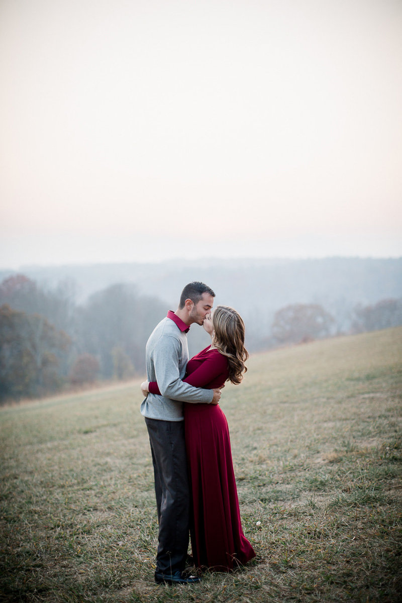 He kisses her with mountains and fog in the background at The Biltmore Mansion by Knoxville Wedding Photographer, Amanda May Photos.