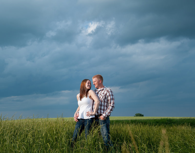Wide open Prairie Skies of North Dakota make an awesome backdrop for engagement photos! Photographers Kris Kandel based in Fargo ND