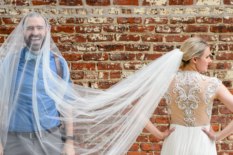 Russ Hickman under a brides veil at a wedding in philadelphia.