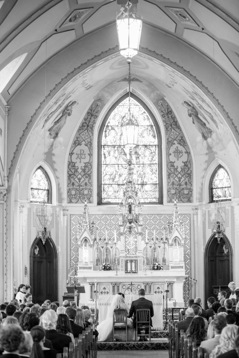 black and white bride and groom at alter of church