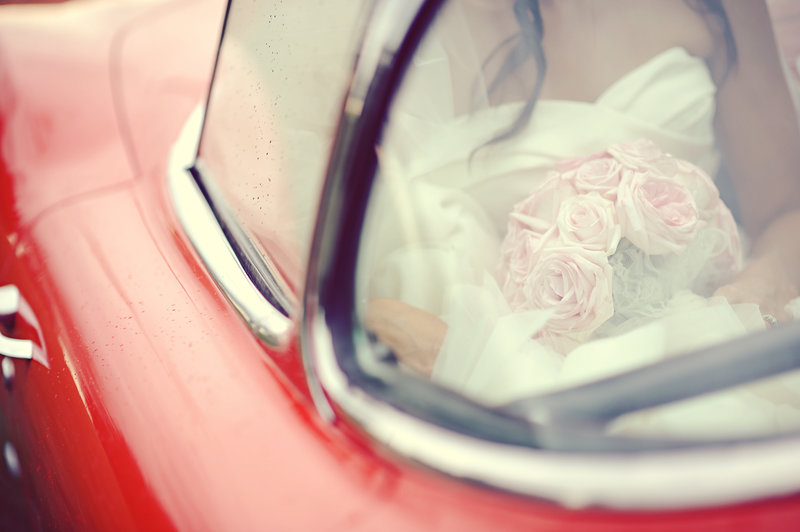 Bride arriving to the wedding in a classic car at a Calgary wedding