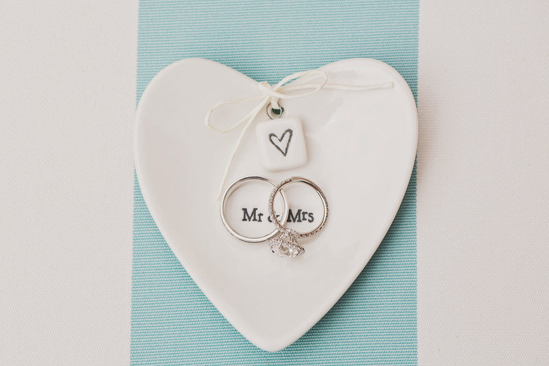 wedding rings in heart shaped ring dish