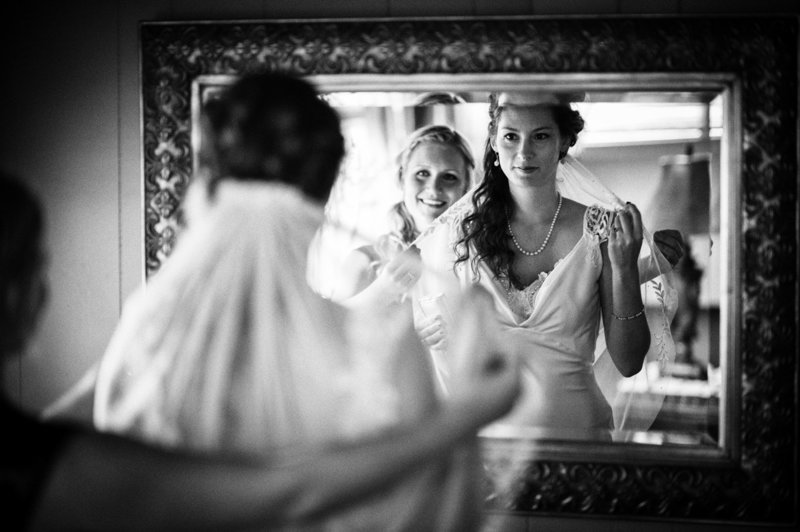 The maid of honor and the bride have a last look at the veil and dress before the wedding at Eagle Crest Resort. Pete Erickson Photography.
