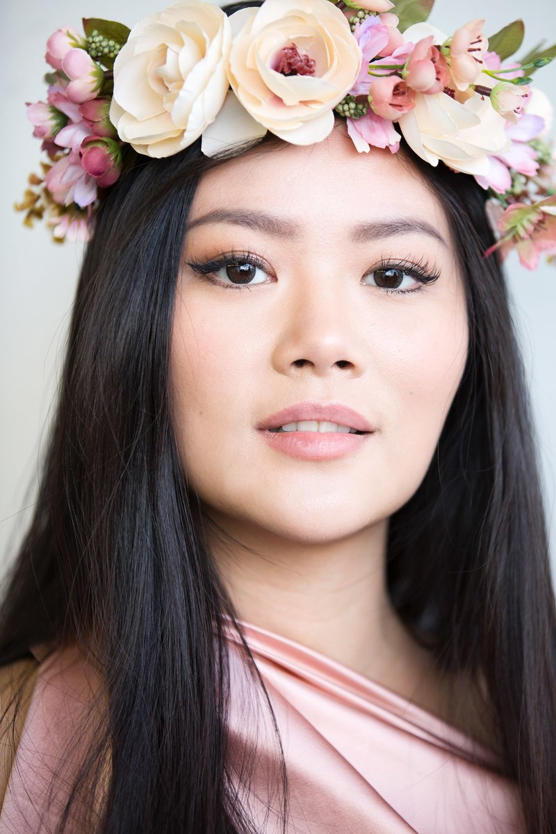 Portrait of a young woman wearing a flower crown