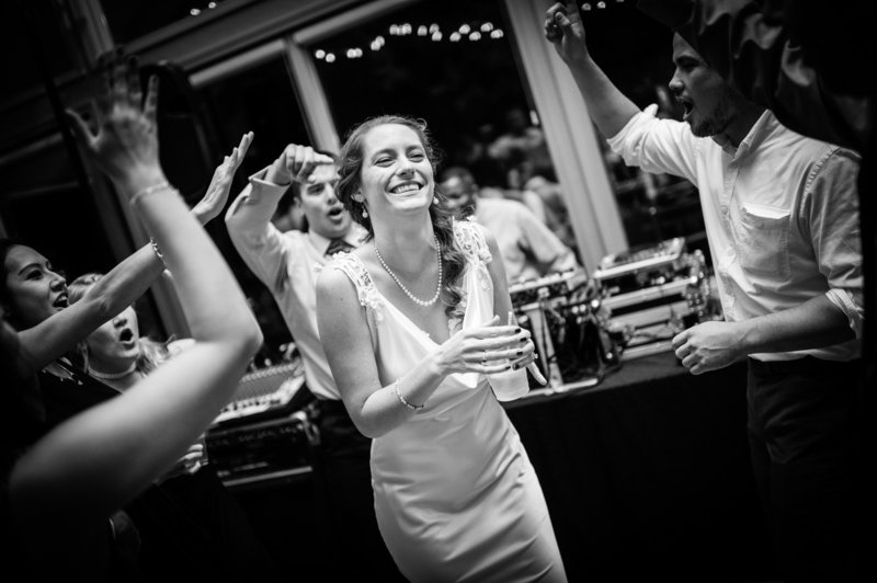 The bride dances with friends at the reception at Eagle Crest Resort. Pete Erickson Photography.