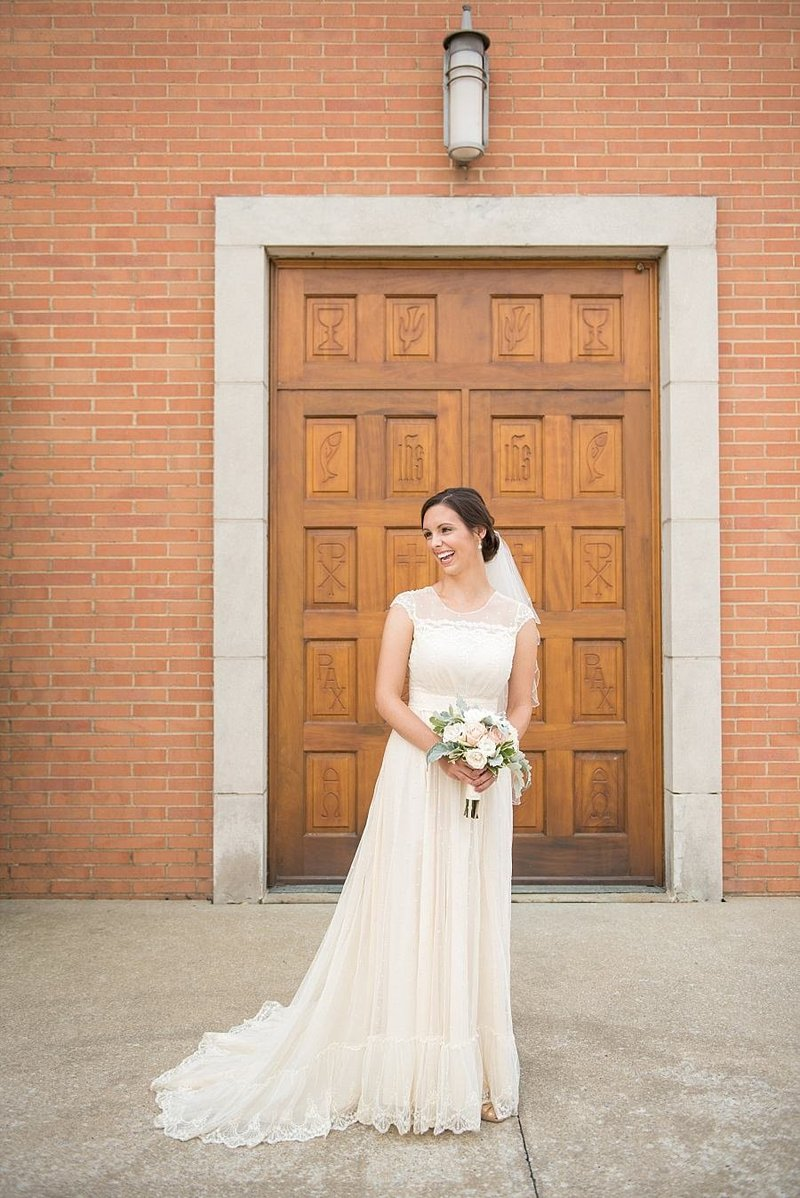 laughter-filled-bride-st-henry-catholic-church-vintage-dress-pink-mint-bouquet