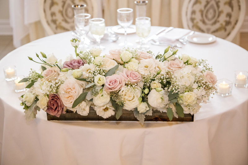 pink and purple flowers at sweetheart table