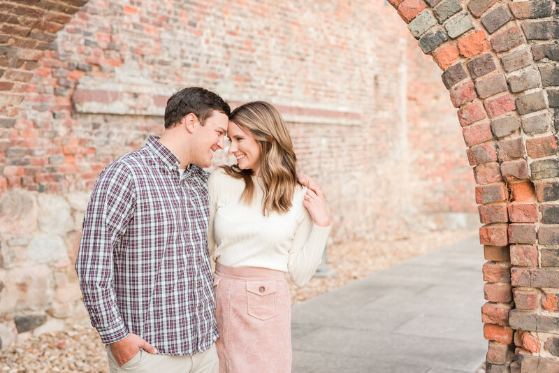 Virginia Engagement Photography Historic Tredegar Ironworks brick archway at James River -1