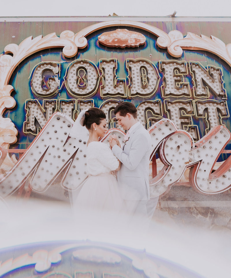 bride and groom get married at iconic neon museum golden nugget sign