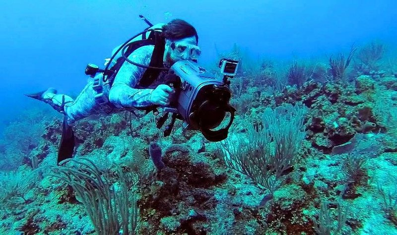 Jason Miller filming underwater cuts while traveling Belize.