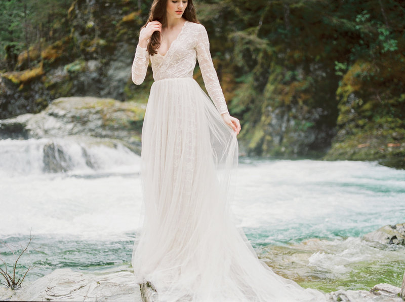 bride in front of waterfall