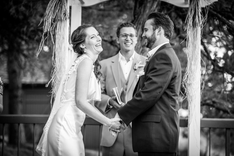 The bride has a laugh during the ceremony at Eagle Crest Resort. Pete Erickson Photography.