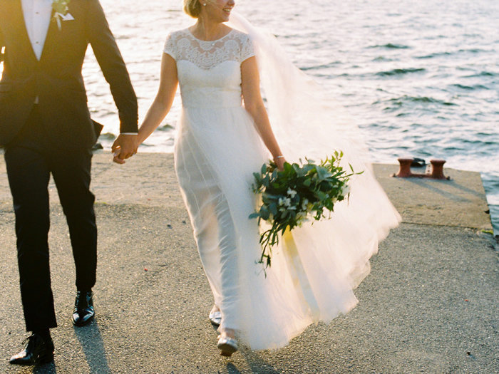 069-sunset-session-by-the-water-bride-and-groom_walking