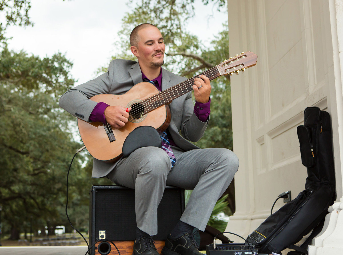 wedding guitarist playing music before wedding ceremony in Audubon Park